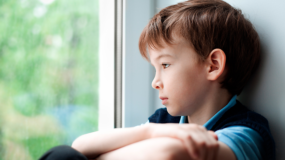 Child looking out a window