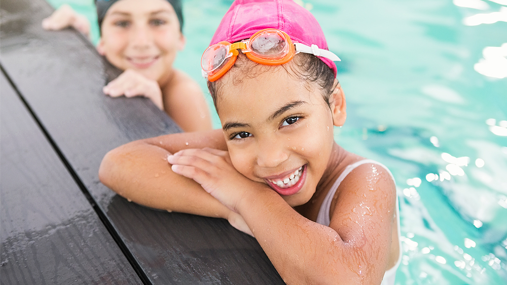 Little girl in a swimming pool with goggles on